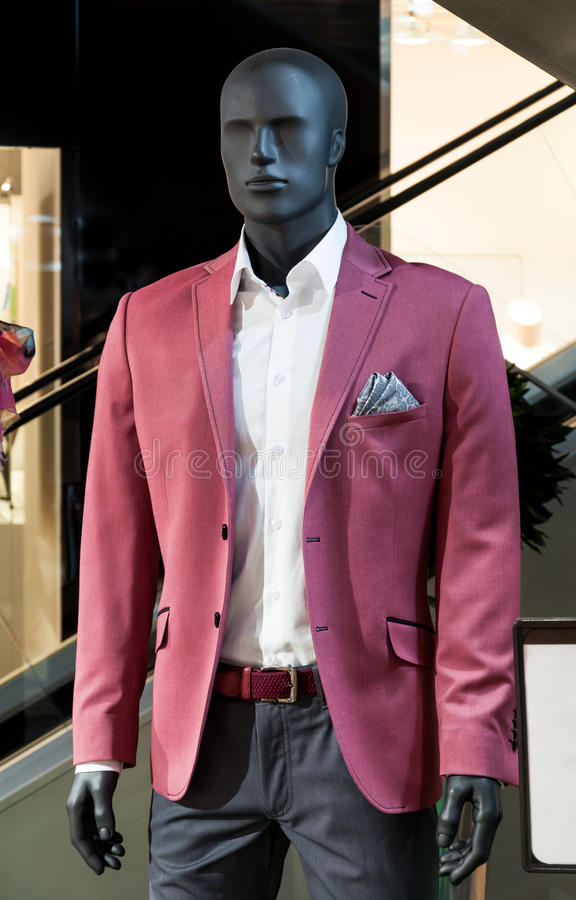 Men's fashion store. Men's suit on mannequin in a fashion store at a shopping mall stock images