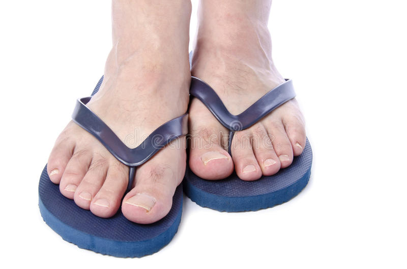 Men's Feet Wearing Navy Blue Flop Flops #2. Men's Feet Wearing Navy Blue Flop Flops Isolated on White #2 royalty free stock photo