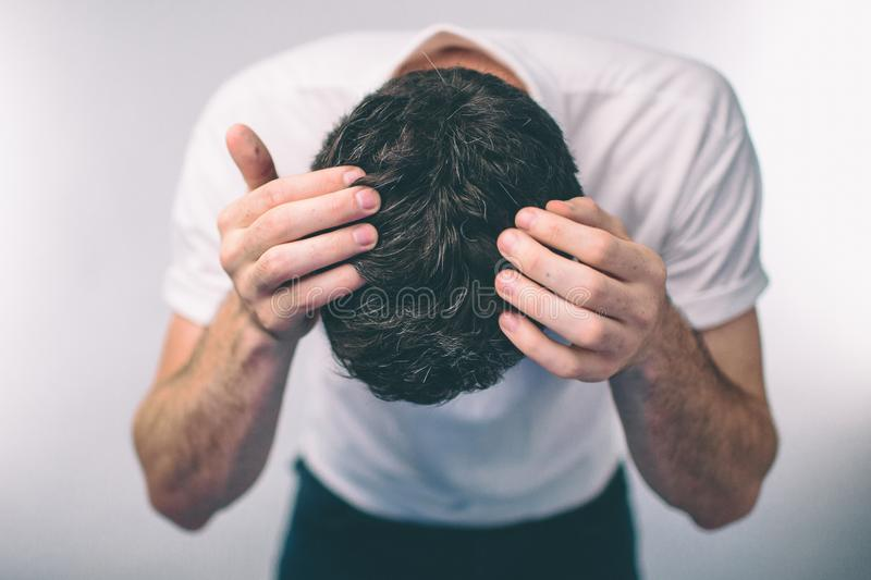 Men`s hair is a top view close-up. ark-haired man Gray hair and Dandruff stock images