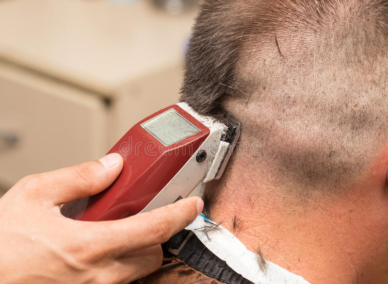 Men`s haircut at the beauty salon machine.  stock photo
