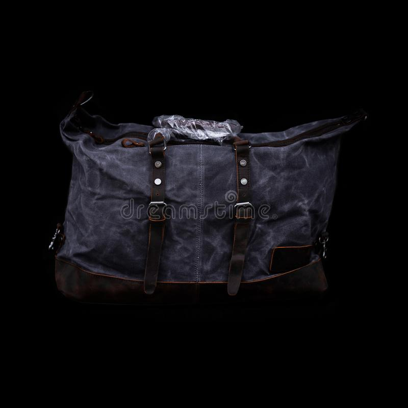 Men`s handbag backpack isolated on black background Sports bag. Men`s handbag backpack isolated on black background Sports bag stock photography