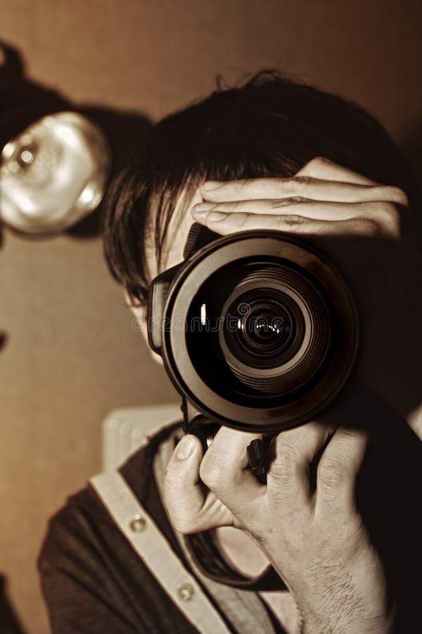 Men's hands held camera stock images