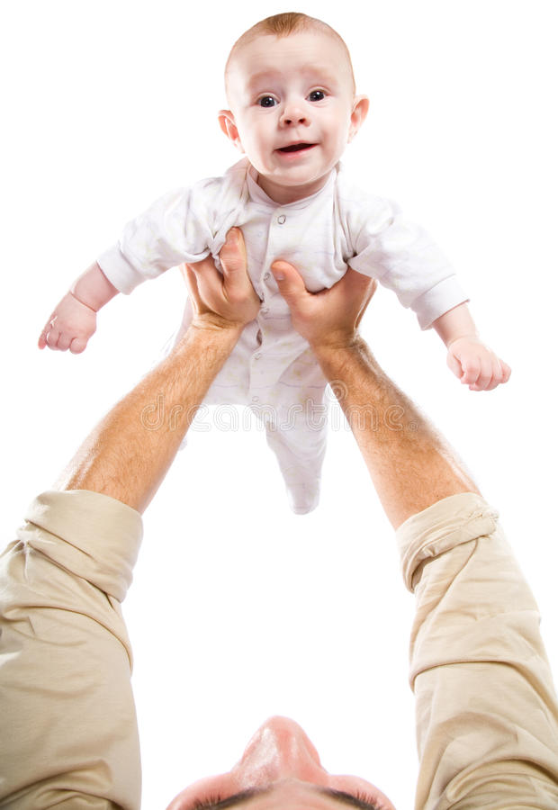 Men's hands hold the baby. On a white background royalty free stock images