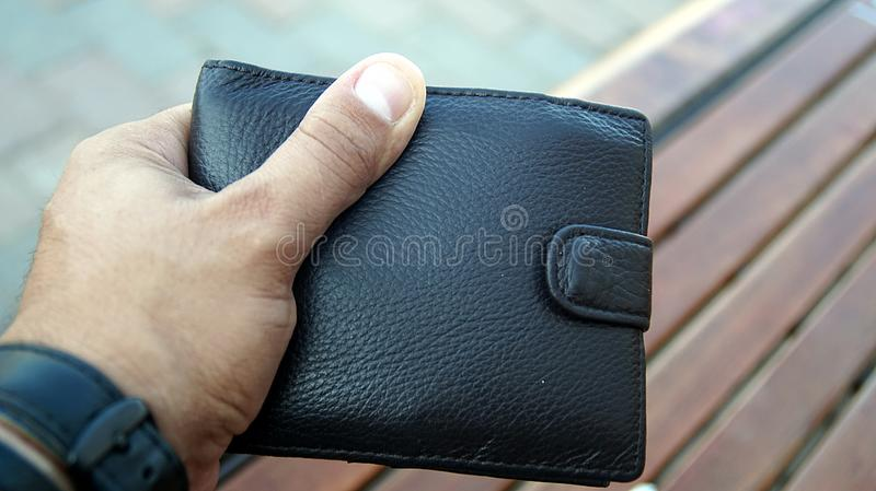 Men`s hands holding leather wallet. royalty free stock photos