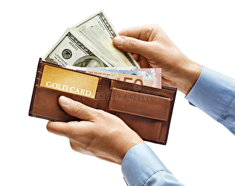 Men`s hands in shirt holding full purse of money isolated stock photos