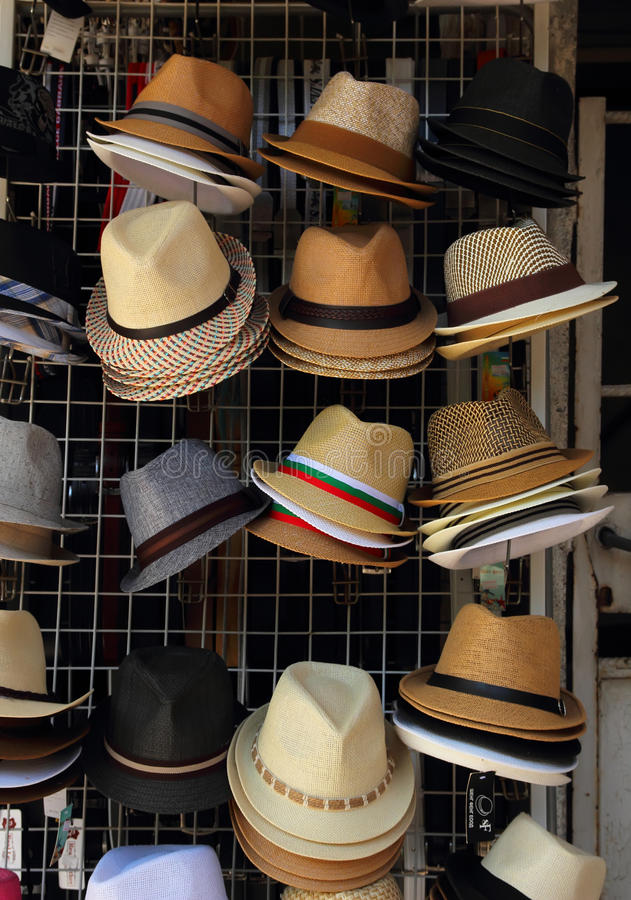 Men's hats are different colors and styles, Pomorie, Bulgaria, July 27, 2014. Men's hats are different colors and styles, hanging in a stall royalty free stock image
