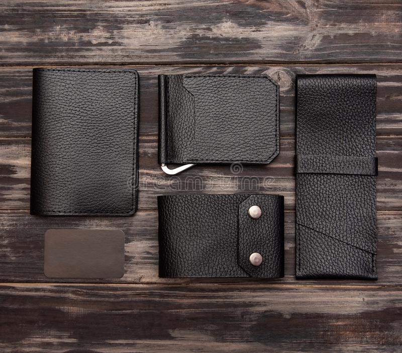 Men`s leather accessories. On a wooden background stock image