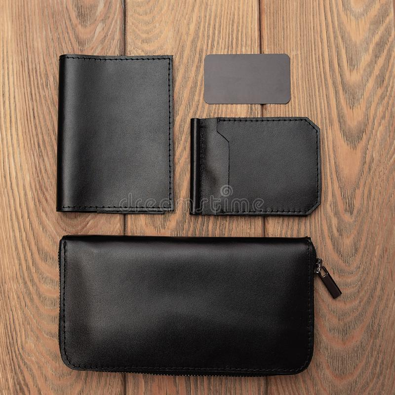 Men`s leather accessories. On a wooden background royalty free stock photography