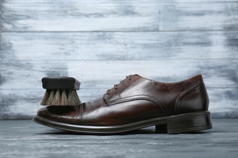 Men`s leather shoes and cleaning brush royalty free stock image