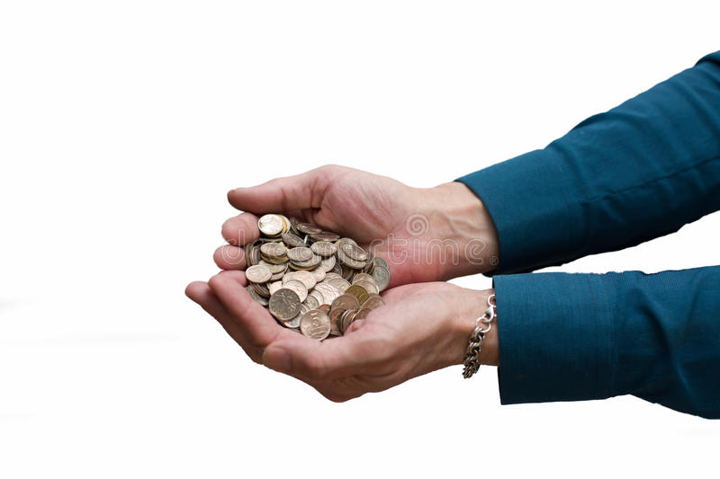 Men's palm with a large circular heap of coins of different denominations. Represent a philosophy of life, poverty, gift, milomtynyu royalty free stock images