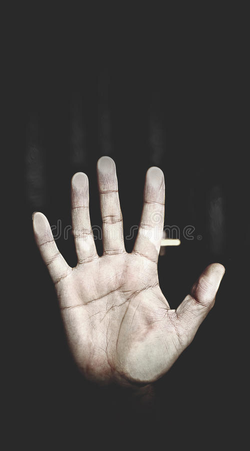 Men's palm pressed to the glass, the metaphor of despair royalty free stock photo