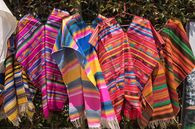 Men`s ponchos in Colombia. Colourful traditional men`s ponchos in Colombia stock photos