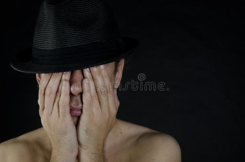 Men`s problems. Black background. Male sex problems royalty free stock image
