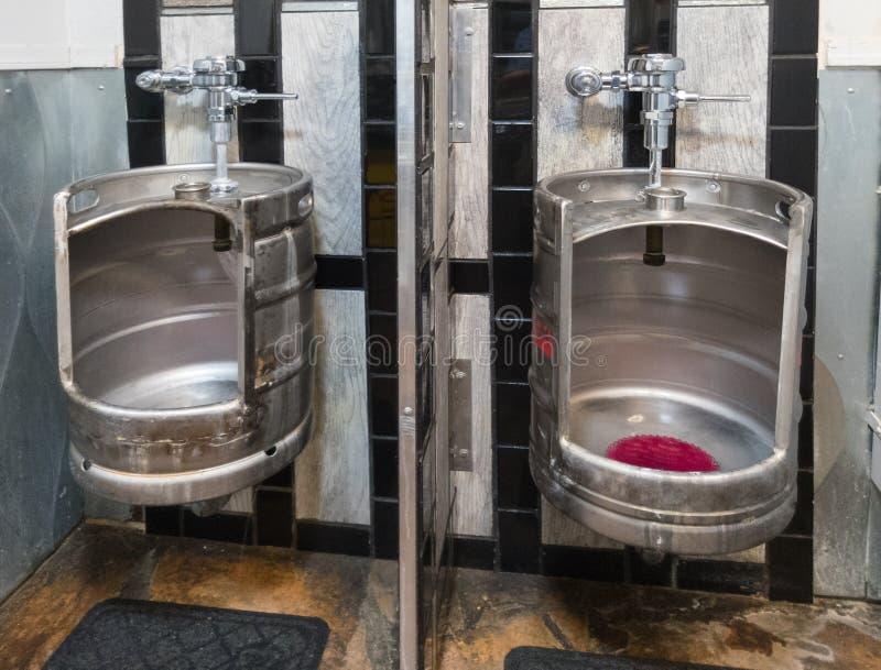 Beer keg urinals in men`s room. Men`s room urinals made from beer kegs stock photography