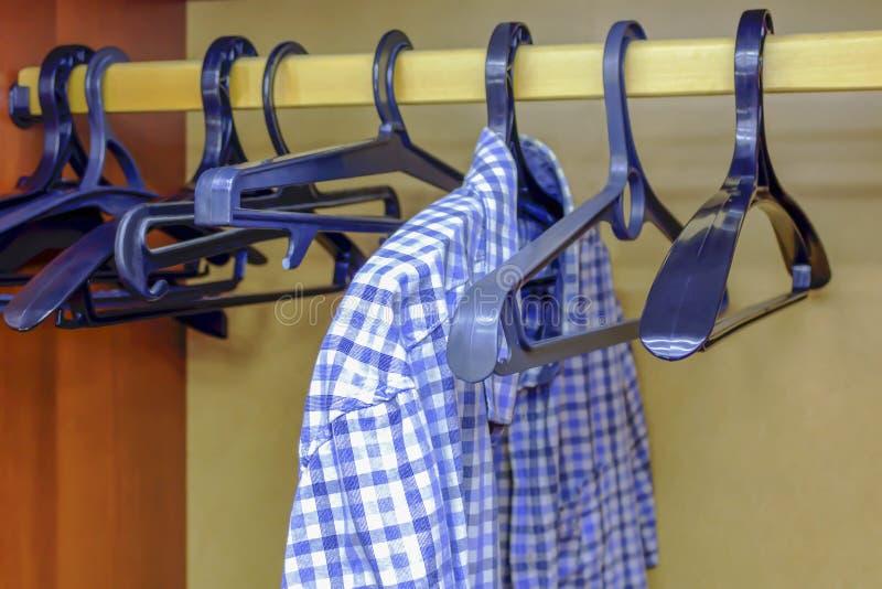 Men`s shirt in an empty closet.  royalty free stock photos
