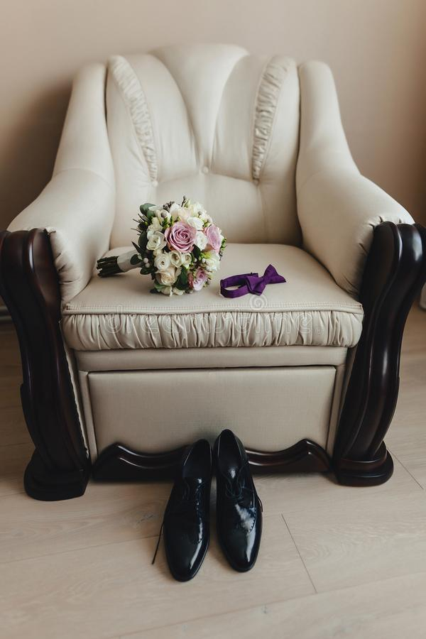 Men`s shoes and elegant clothes, holiday theme and wedding stock photography