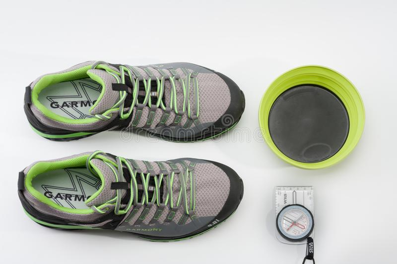 Men´s shoes Garmont , magnetic compass and silicone plate stock images