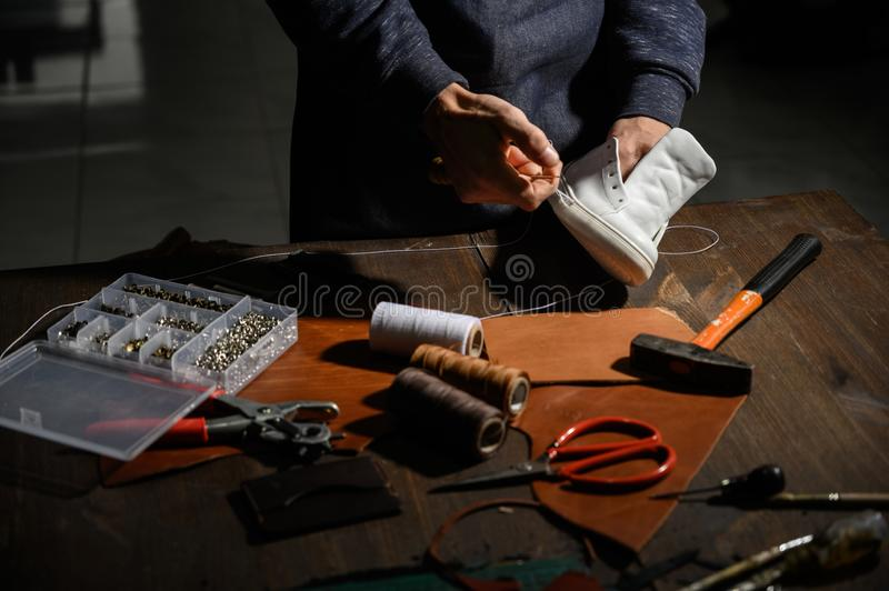 Men`s shoes made of leather leather, the shoemaker workshop. shoemaker performs shoes. In the studio craft stock images