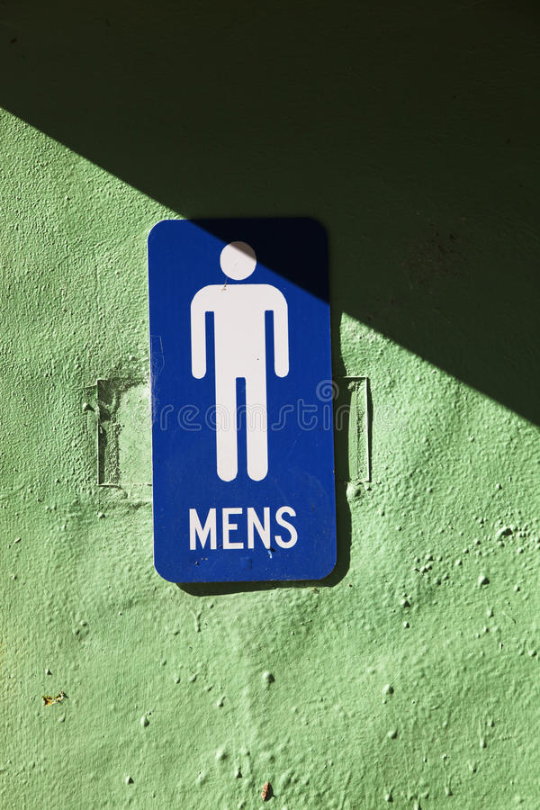 Men's toilet. Sign in blue and white royalty free stock photos