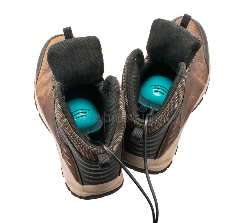 Men`s walking boots with shoes dryer, back view. Brown men`s walking boots with shoes dryer, back view, isolated on white background stock photo
