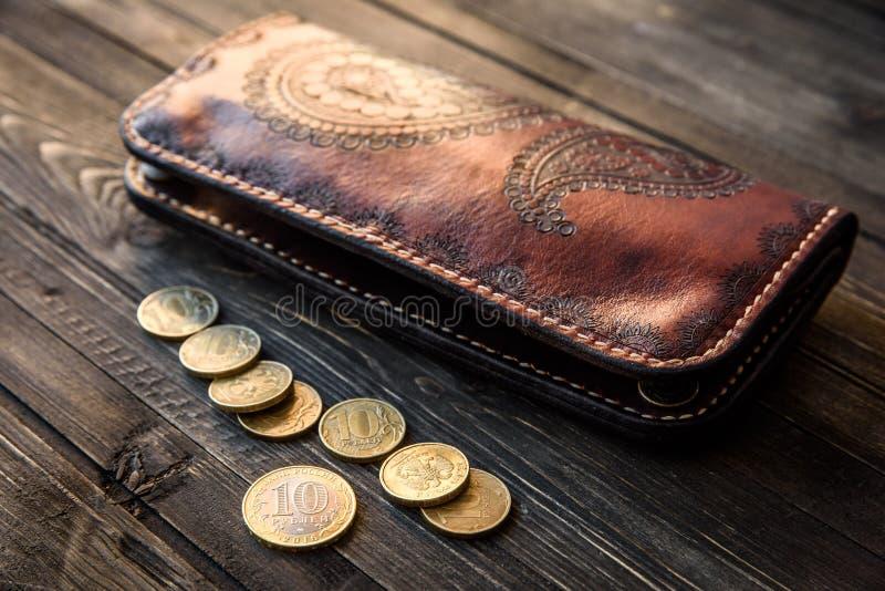 Men`s wallet money in cash wooden white vintage background stock photos
