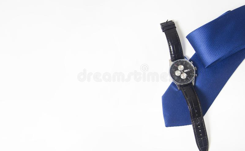 Men`s watch and tie on white background. Men`s accessories on white background royalty free stock photos