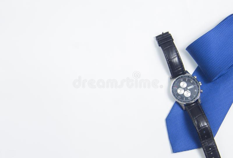 Men`s watch and tie on white background. Men`s accessories on white background stock photo