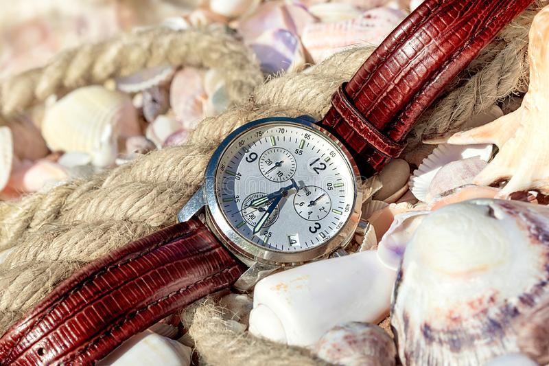 Men`s watches on the seashore royalty free stock photography
