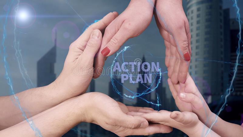Men`s, women`s and children`s hands show a hologram Action plan. The family holds a magical inscription on the background of a modern city royalty free stock image