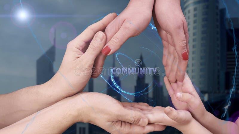 Men`s, women`s and children`s hands show a hologram Community stock photos