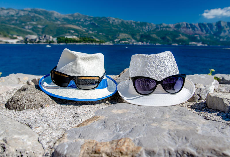 Men's and women's beach hat. And sunglasses royalty free stock images