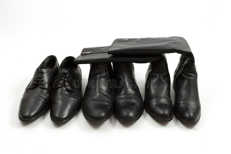 Men`s and women`s black shoes isolated, white background royalty free stock images