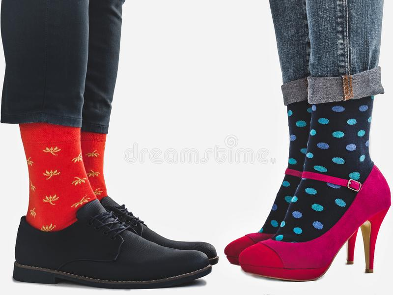 Men`s and women`s trendy shoes, bright socks stock image