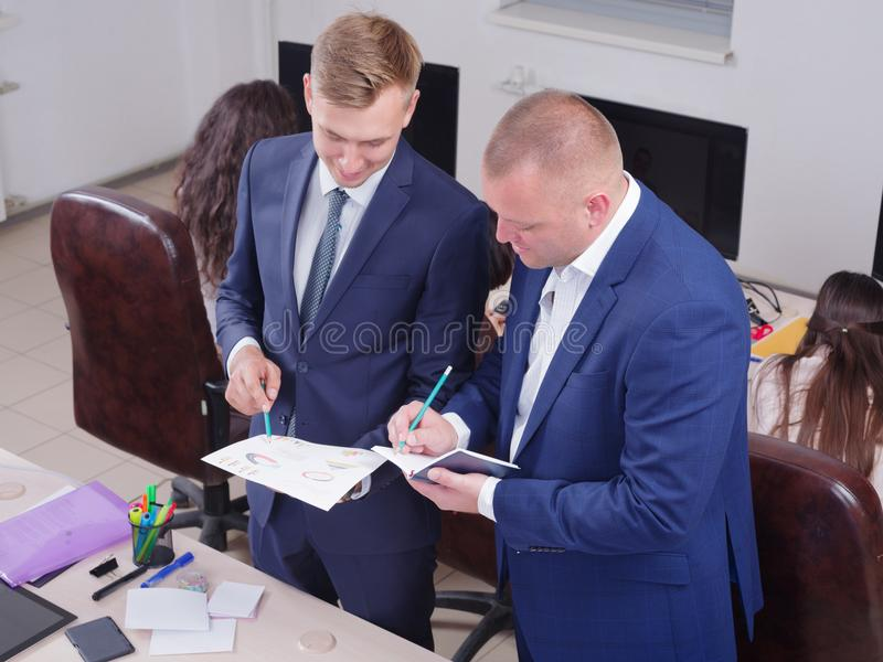 Young colleagues working in the office on a schedule. royalty free stock images