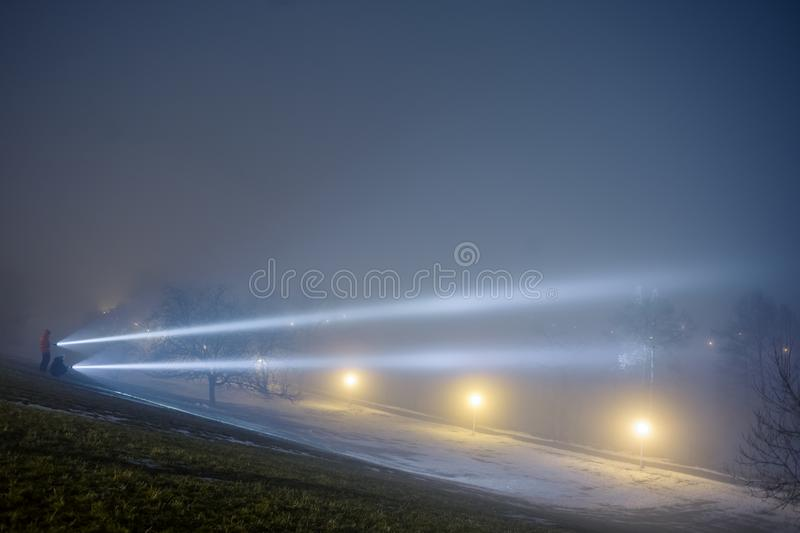 Men searching with flashlights at night. stock photography