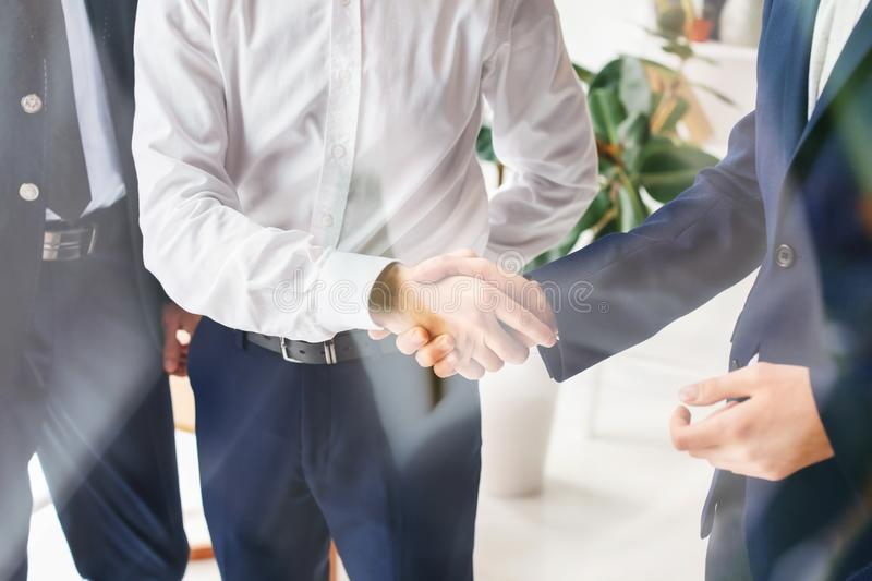 Men shaking hands during business meeting in office royalty free stock photo