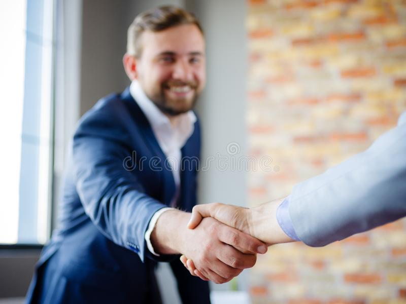 Men shaking hands. Confident businessman shaking hands with each other. stock photo