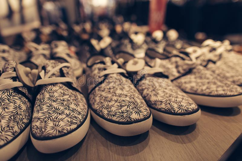 Men shoes in clothes store. Stylish young men`s shoes in a clothing store. Shopping concept stock photography
