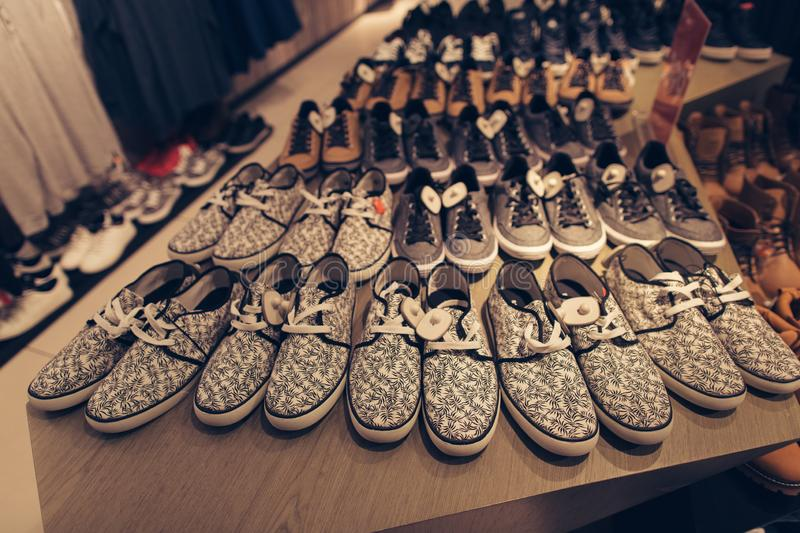 Men shoes in clothes store. Stylish young men`s shoes in a clothing store. Shopping concept royalty free stock image