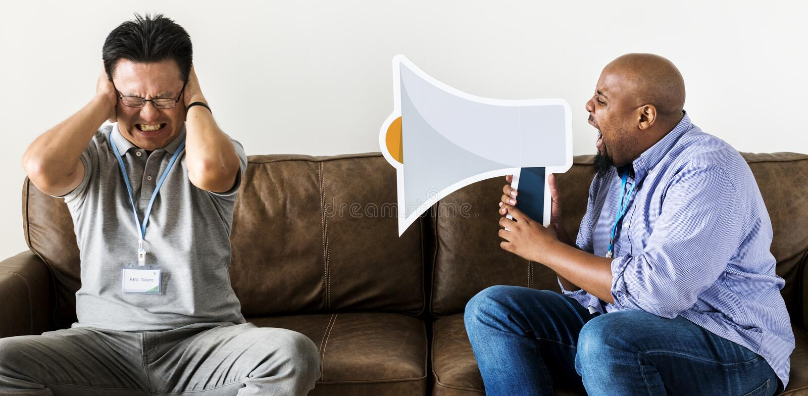 A man shouting at another man stock image
