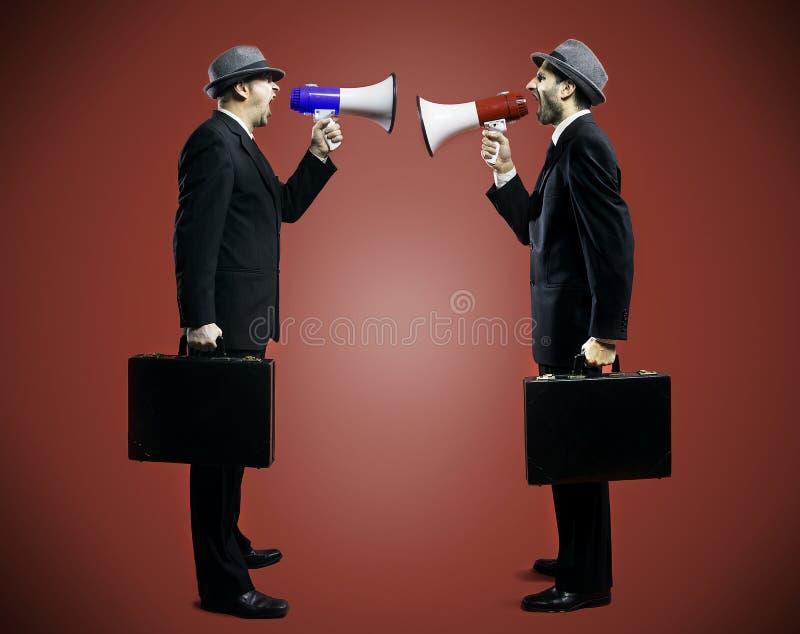 Men shouting in a megaphone. 2012-09-24 stock image
