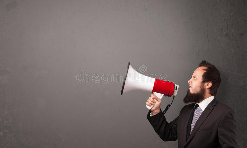 Men Shouting Into Megaphone On Copy Space Background Royalty Free Stock Images