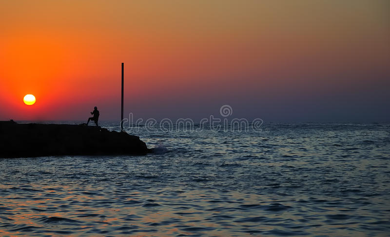 Men silhouette on the sea background stock photos