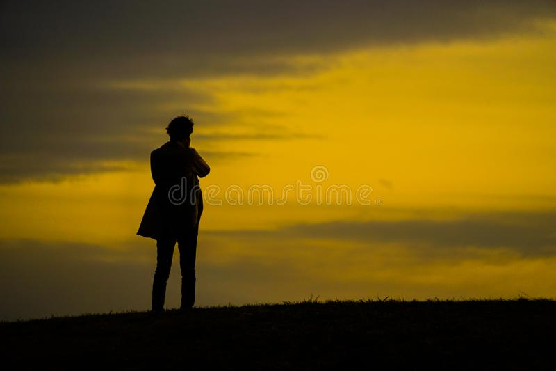 Men silhouette standing on a hill. Shooting location :  Mitaka City, Tokyo stock photography