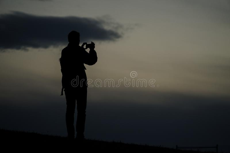 Men silhouette standing on a hill. Shooting location :  Musashino-shi, Tokyo stock photography