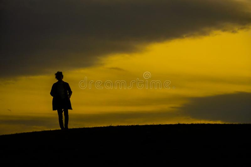 Men silhouette standing on a hill. Shooting location :  Mitaka City, Tokyo stock images