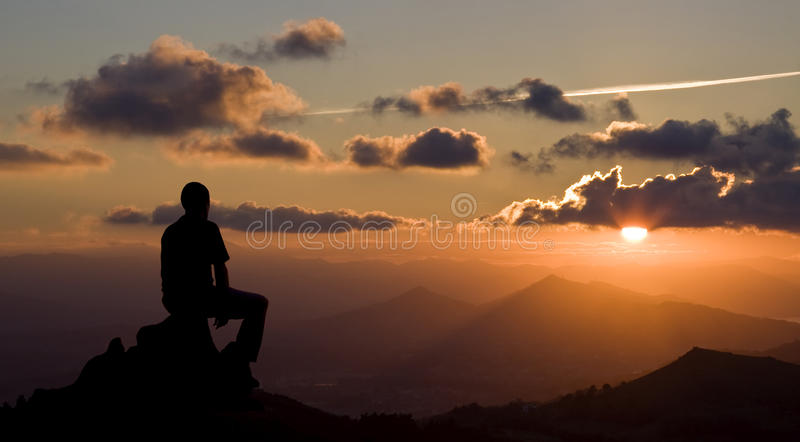 Men silhouette on the sunset background stock images