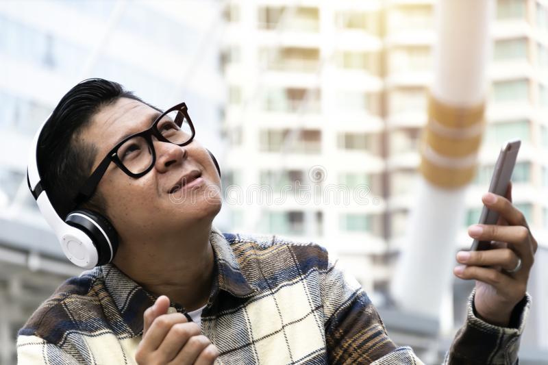 Men are sitting happily listening to music. royalty free stock images