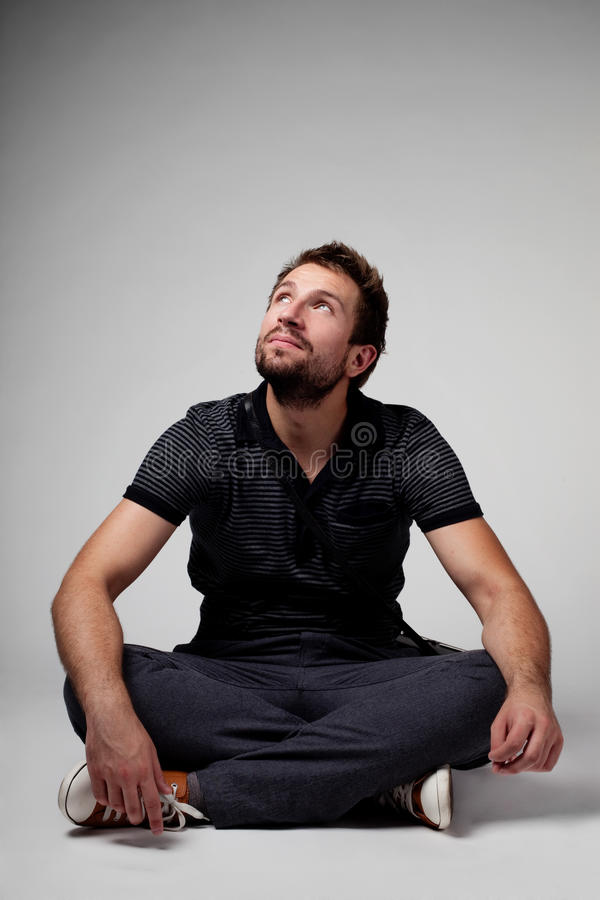 Download Men sitting and looking up stock photo. Image of handsome - 25469810