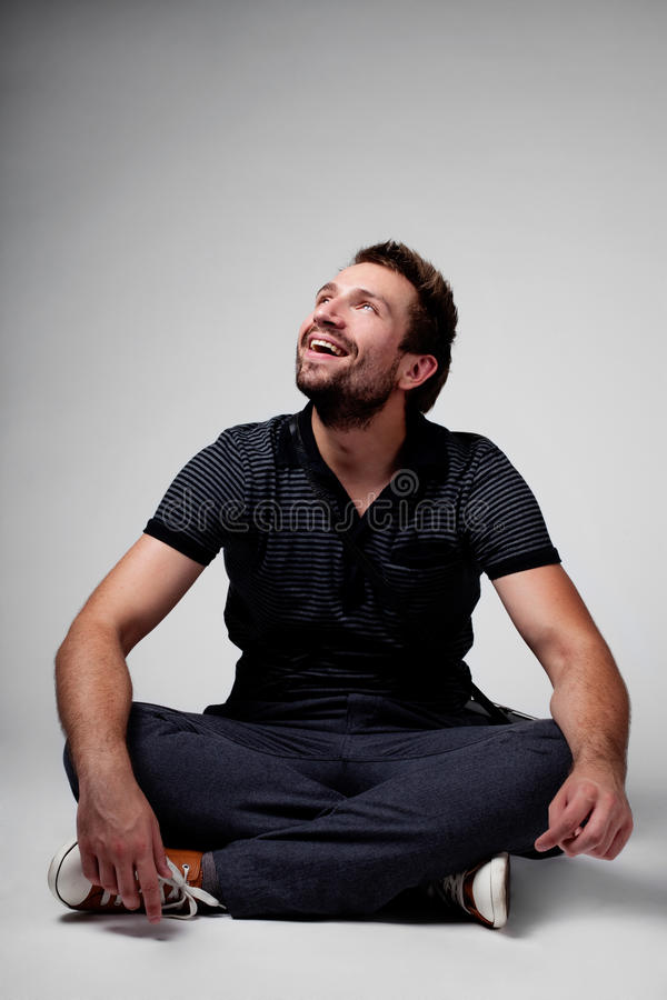 Download Men sitting and looking up stock photo. Image of dark - 25469882